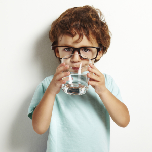 boy drinking a glass of water